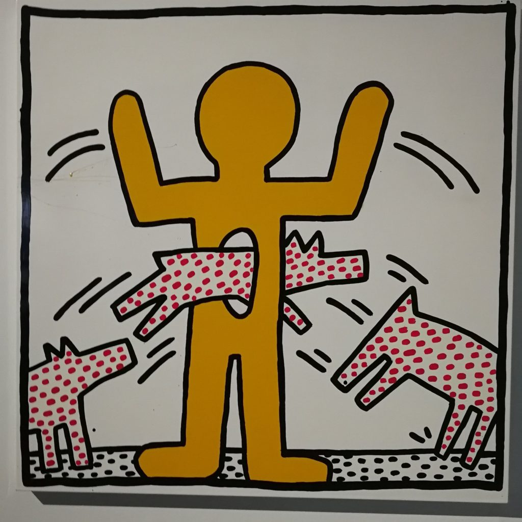 Keith Haring yellow man with jumping spotty dogs