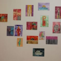 Wall covered in colourful paintings of Palestinian buildings
