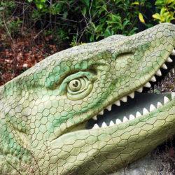 head of a reptilian dinosaur sculpture