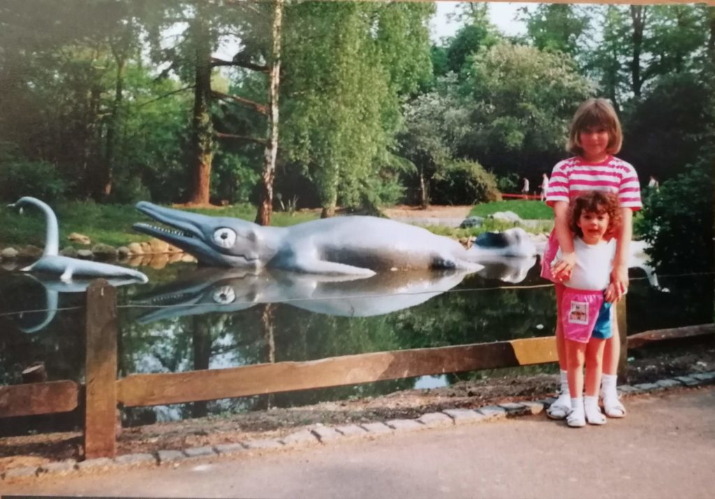 1980s children standing by crystal Palace dinosaurs