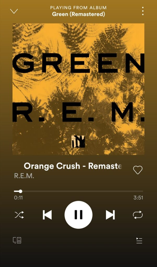 "Screenshot of Spotify screen showing album cover of ""Green"" play ""Orange Crush"""