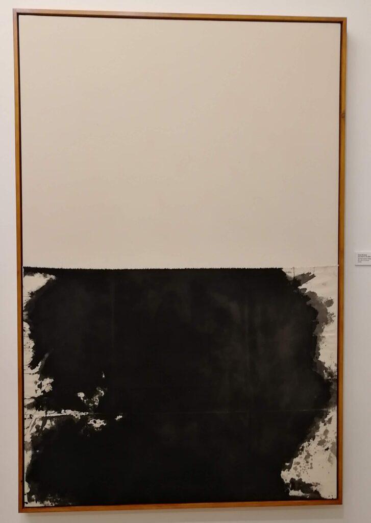 Top half is plain white, bottom half has black spread out like a random pattern