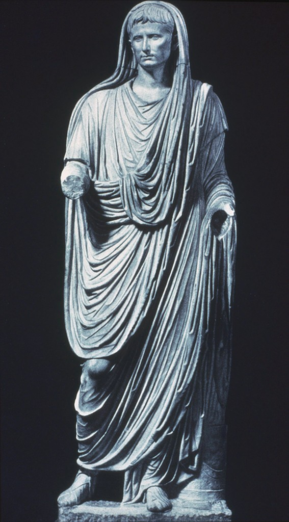 Photo of a sculpture of Emperor Augustus as Pontifex Maximum, dressed in swathes of robes.