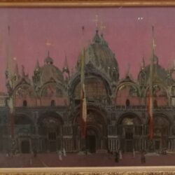 a painting of St mark's. venice, with a pink sky. The building has three domes and red and yellow flags hanging outside.
